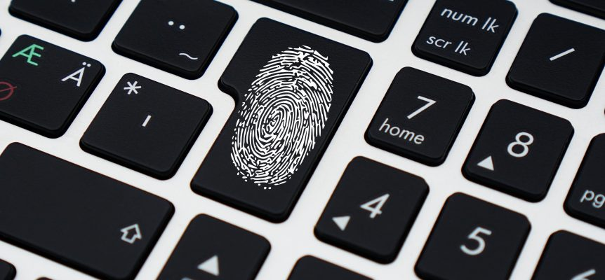 Enter button on a keyboard with a visible fingerprint on it.